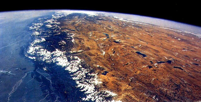 On this photo from cosmos one can see flood-lands of the river Gang (in the left), peaks of Himalayas and Tibetan plateau, covered with snow (in the right). (Photo of NASA)